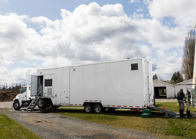 Used mobile slaughterhouse in white trailer format for meat processing on farm or ranch