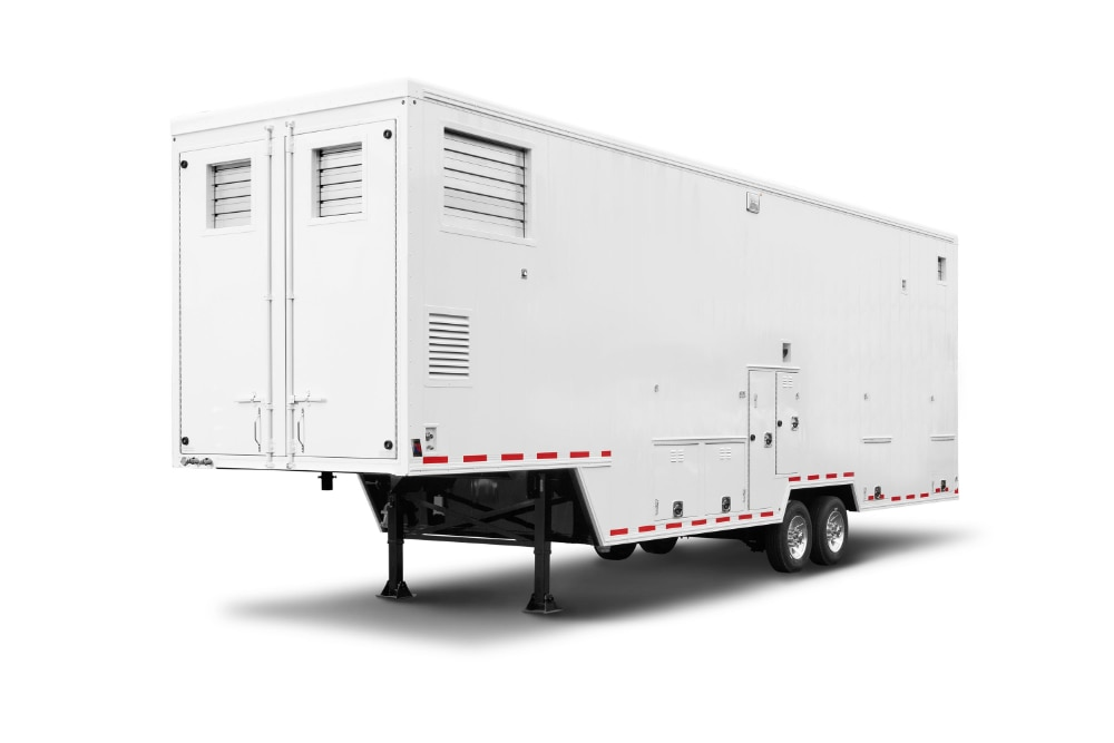 Mobile harvest unit in white trailer format used for meat processing on farm or ranch
